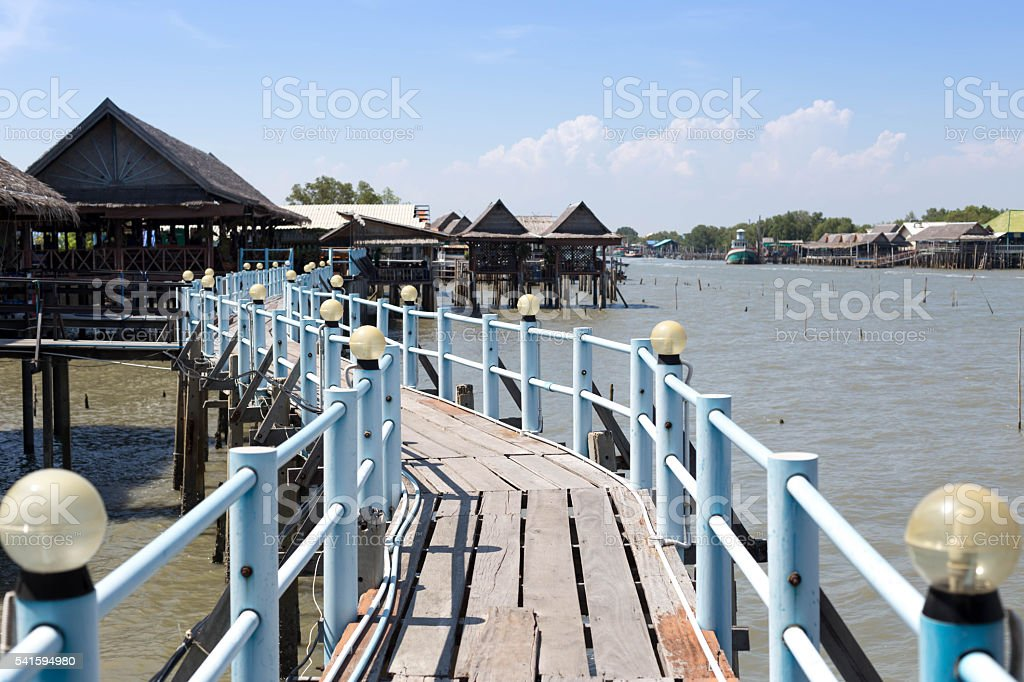 Embouchure bridge with restaurant and houses in the fishing vill stock photo