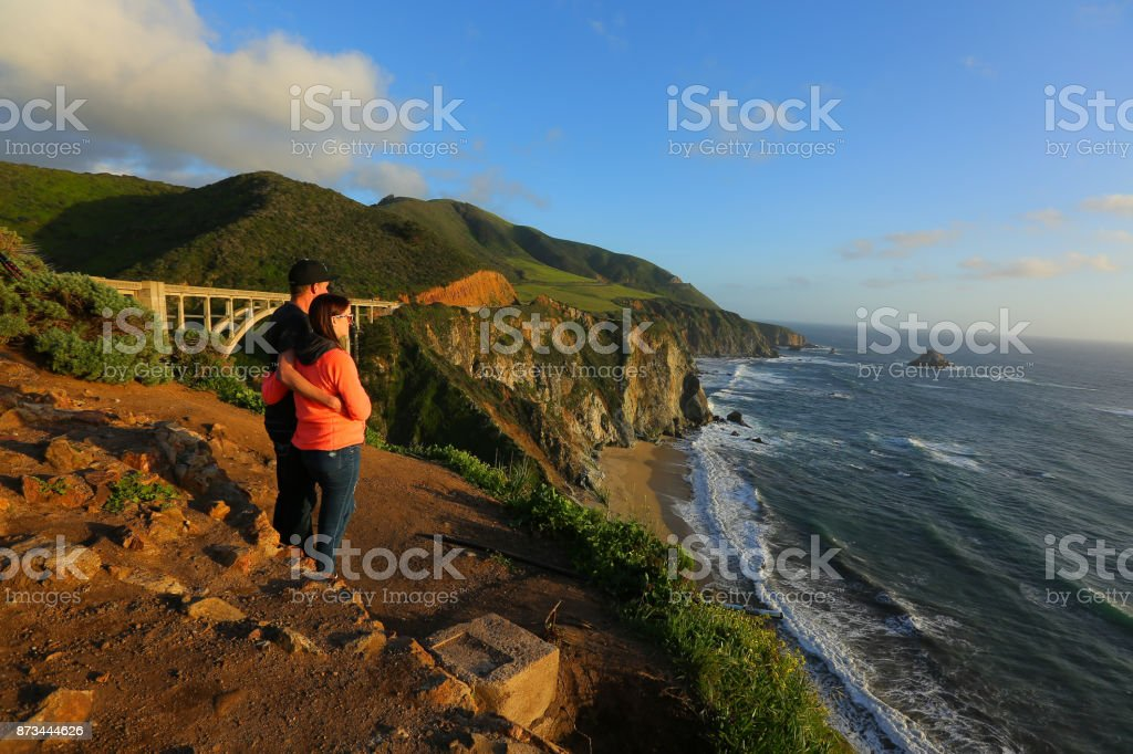 embrace at sunset stock photo