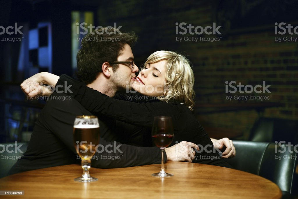 Embrace Couple in a Bar royalty-free stock photo