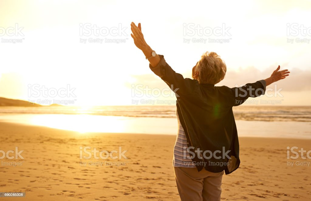 Embrace life with open arms stock photo