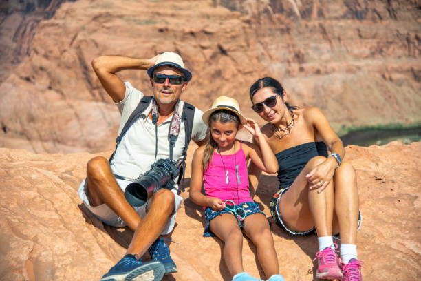 Embrace nature. Portrait of happy family on vacation in Usa.  Horseshoe bend. Page. Arizona. Usa Embrace nature. Portrait of happy family on vacation in Usa.  Horseshoe bend. Page. Arizona. Usa. page arizona stock pictures, royalty-free photos & images