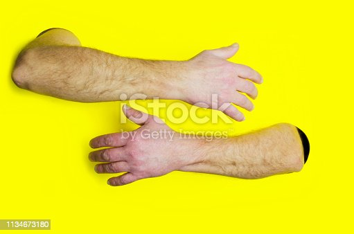 istock Embrace or hugging design template.Male hands hugging somebody against yellow background.Concept of support 1134673180
