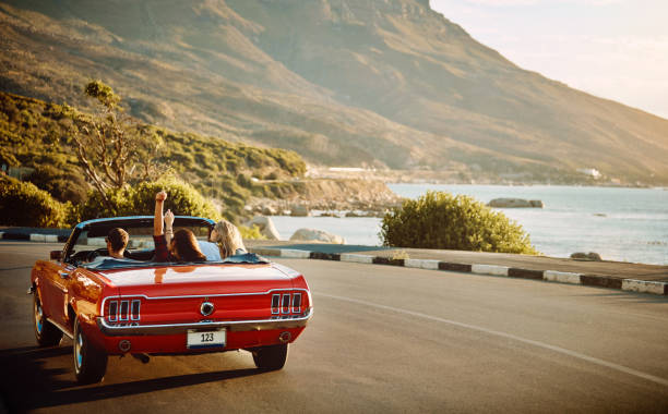 Embrace the open road with open arms Shot of happy young friends enjoying a summer's road trip together road trip stock pictures, royalty-free photos & images