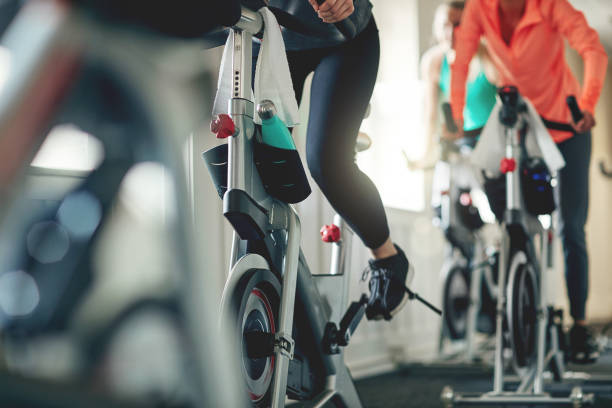 embrace the power of a bike - health club stock photos and pictures