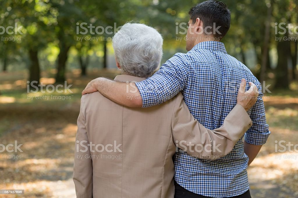 Embraced grandson and grandfather stock photo
