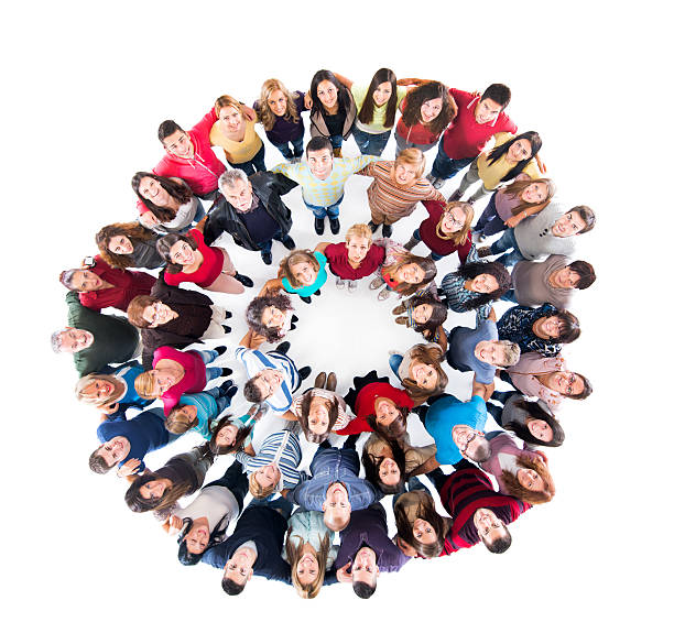 Embraced group of happy people in a circle. stock photo