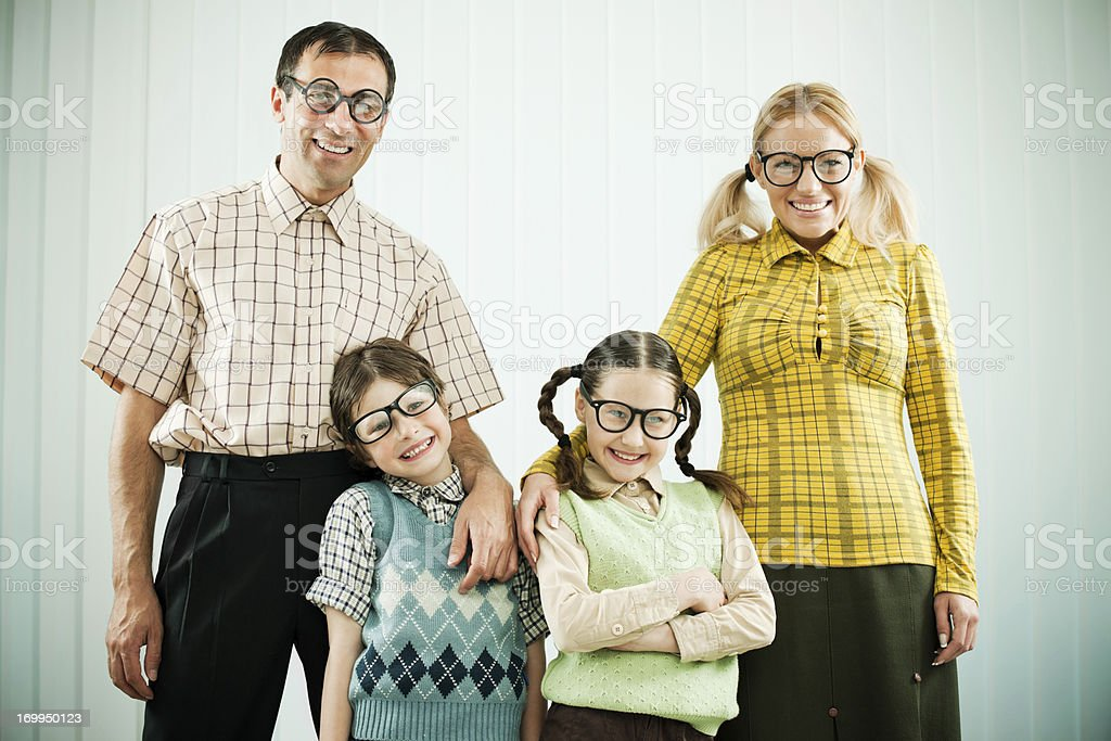 Embraced nerd family looking at the camera. royalty-free stock photo