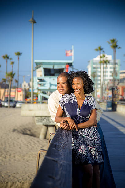 Embracing Couple Smiles on Venice Pier stock photo