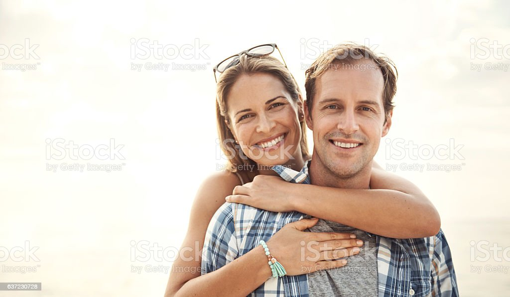 Embracing each other under the sun stock photo