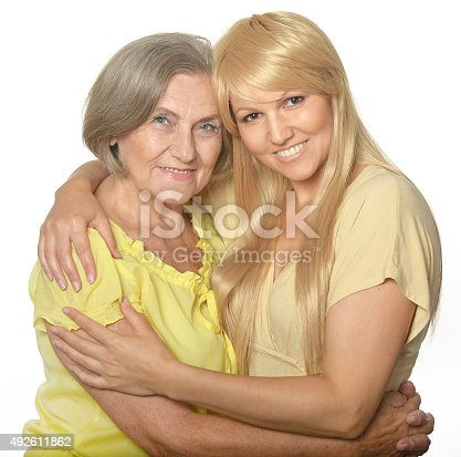 istock Embracing mom and daughter 492611862