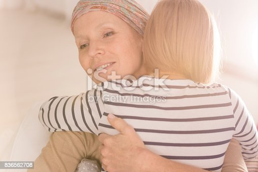637119208 istock photo Embracing mother suffering from leukemia 836562708