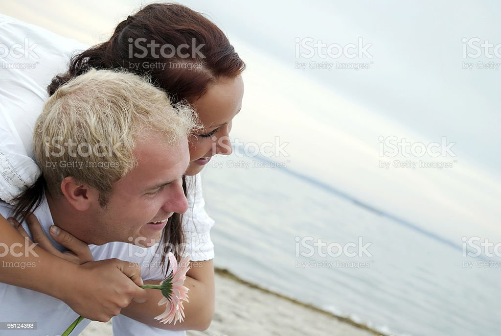 Embracing partners on beach royalty-free stock photo
