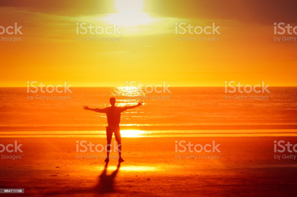 Embracing the sunset royalty-free stock photo