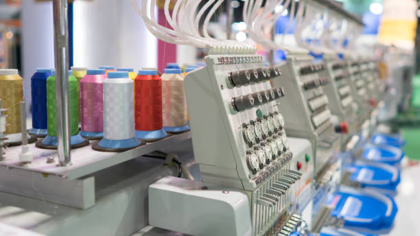 embroidary machine with colorful thread - embroidery machine stock pictures, royalty-free photos & images