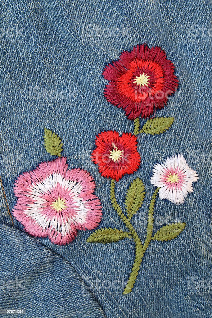 embroider flower on jeans stock photo