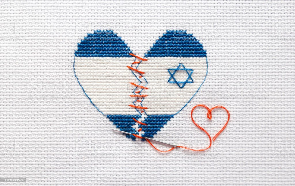 Embroider the broken heart of the colors of the flag of Israel sewed...