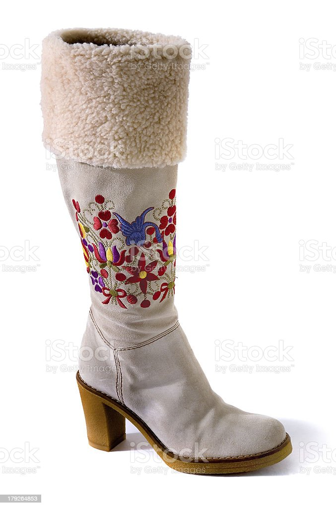 Embroidered flowers and birds shearling cuff white suede boots stock photo