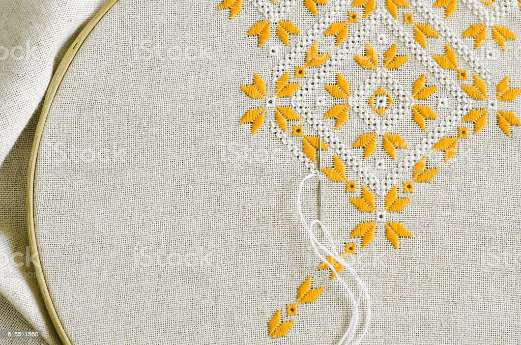 Embroidered fragment by cotton threads. Embroidery texture flat stitch. stock photo