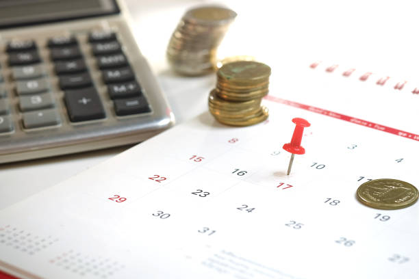 Embroidered red pins on a calendar on the 17th with selective focus, Tax day Concept stock photo