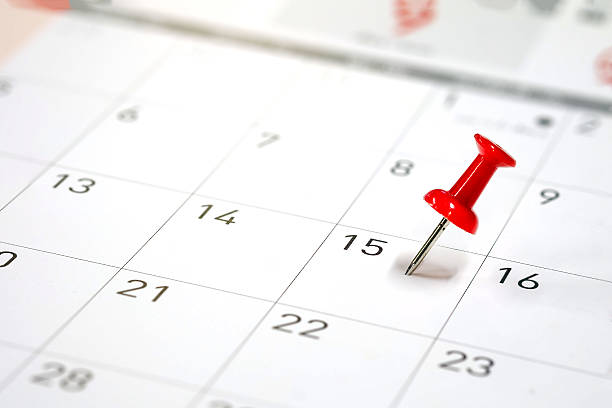 embroidered red pins on a calendar - deadline stock pictures, royalty-free photos & images