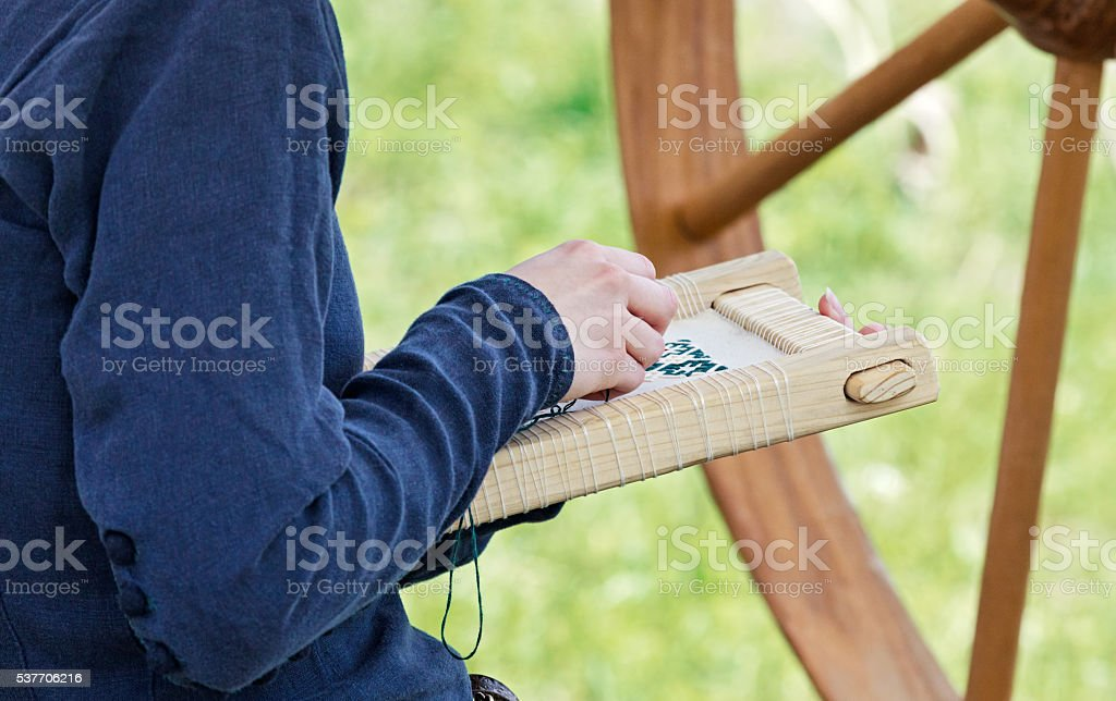 Embroideress at work stock photo