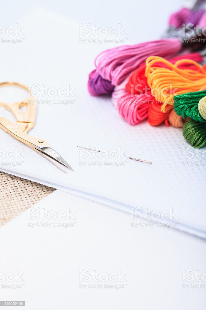 Embroidery floss and needle stock photo