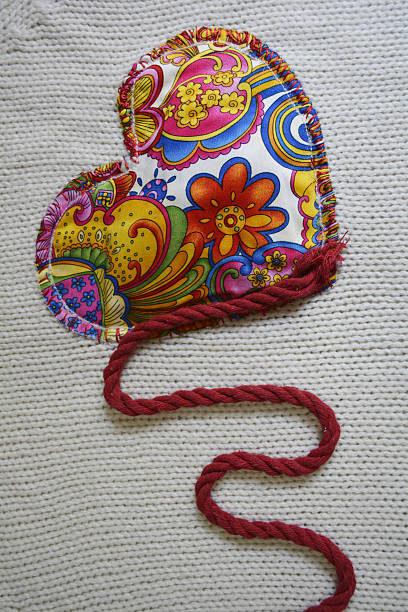 embroidery heart bright multi-colored embroidered heart on knitted background devolve stock pictures, royalty-free photos & images