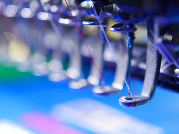 embroidery machine - sewing machine needle stock photos and pictures