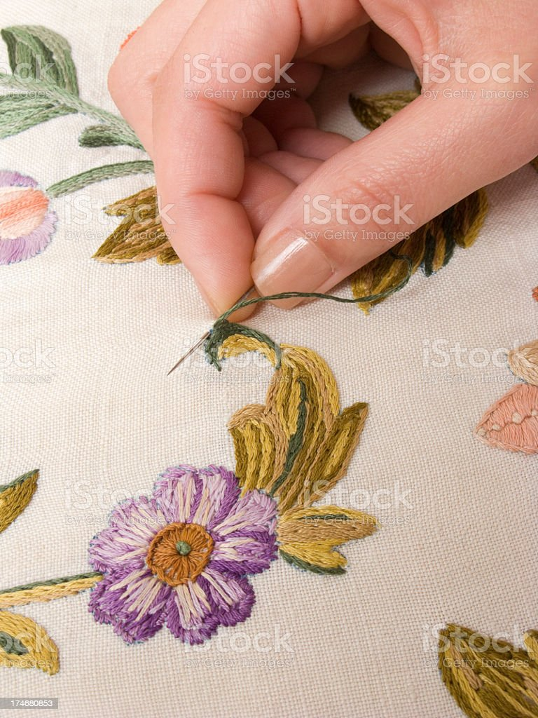 Embroidery needle hand royalty-free stock photo