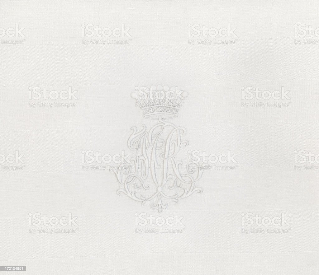 Embroidery of a crowned Monogram royalty-free stock photo