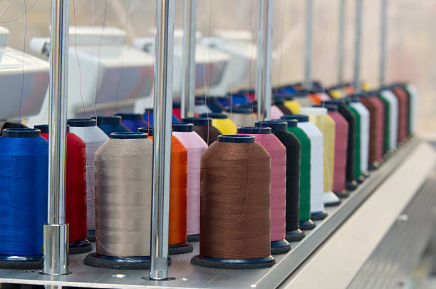 embroidery spools of thread - embroidery machine stock pictures, royalty-free photos & images