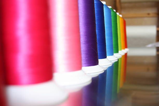 embroidery thread spools - embroidery machine stock pictures, royalty-free photos & images