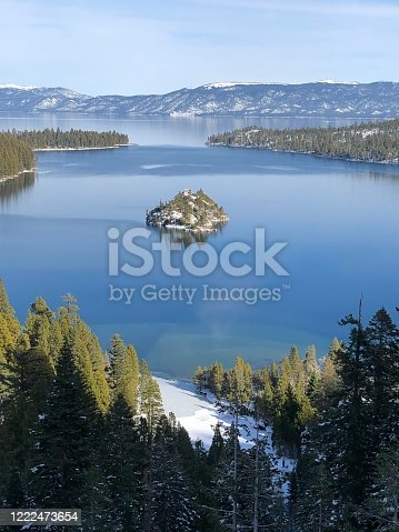 Looking out at Emerald Bay and Fannette Island, the only island on Lake Tahoe, during a sunny afternoon on a winter day in Emerald Bay State Park, one of the most popular tourist destinations in the Lake Tahoe region of California.
