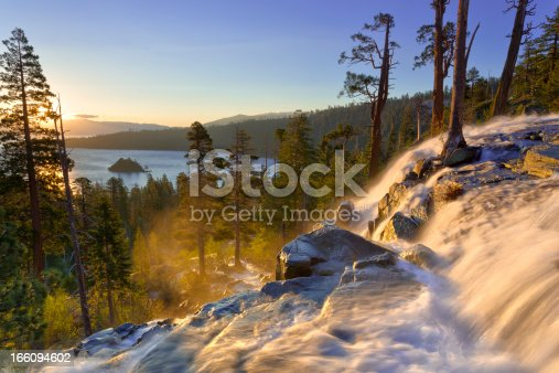 Sunrise overlooking Lake Tahoe's Emerald Bay in the background, with the upper portion of Lower Eagle Falls in the foreground; HDR.