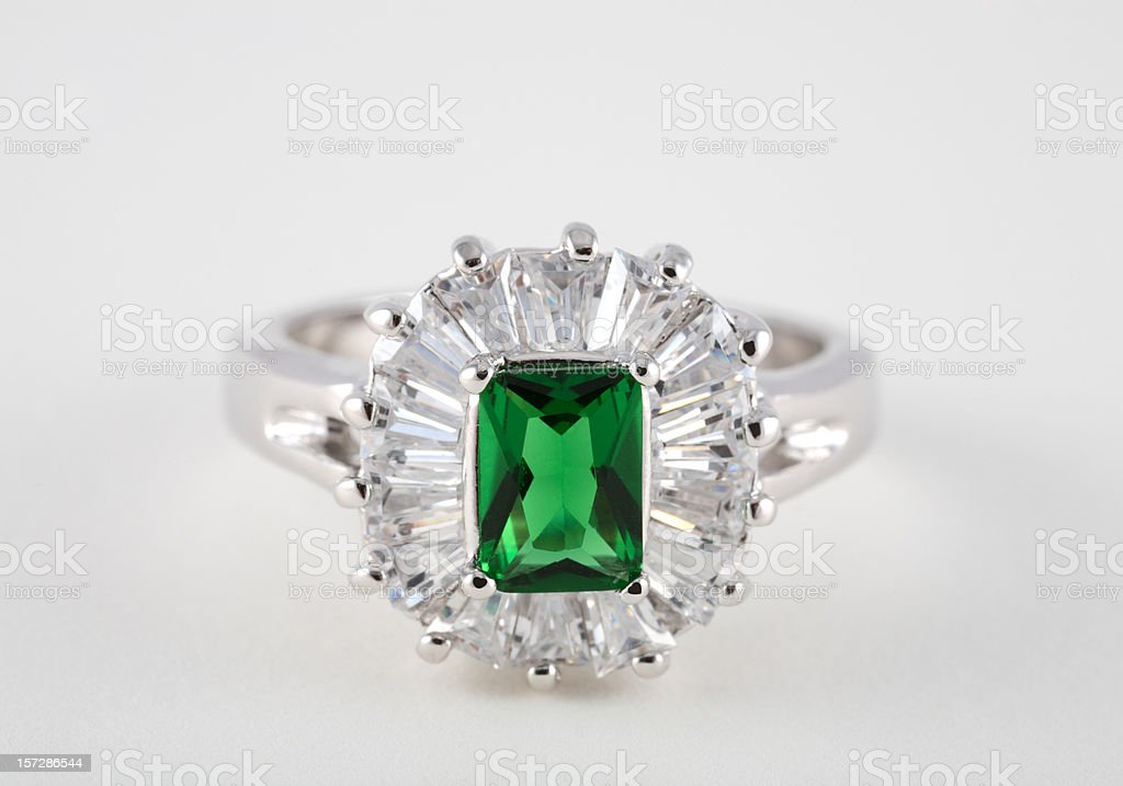 Emerald diamond ring on white background stock photo