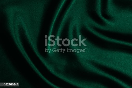 Emerald green satin background.