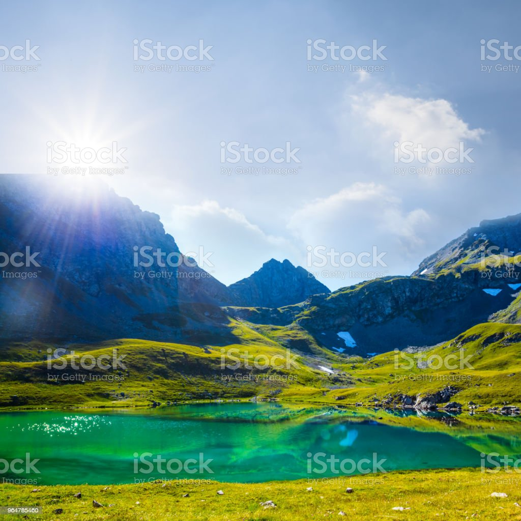 emerald lake among a mountains royalty-free stock photo