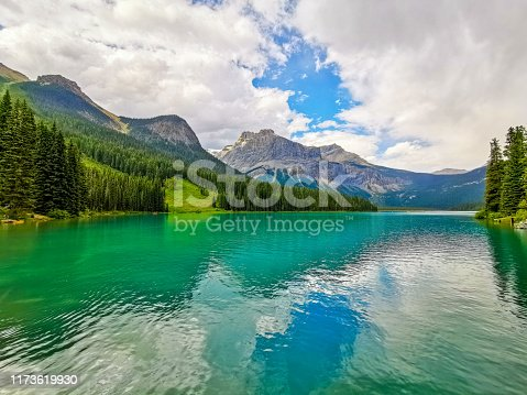 Emerald Lake is located in Yoho National Park, British Columbia, Canada, and it is the largest of 61 lakes and ponds located in this park. It is pictured here with the President Range of mountains.