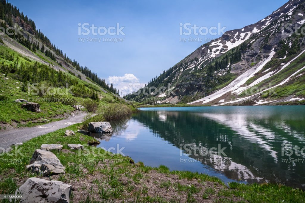 Emerald Lake, Crested Butte, Colorado Emerald Lake, near Crested Butte, Colorado, is a clear, glacier lake surrounded by high mountain peaks. Colorado Stock Photo