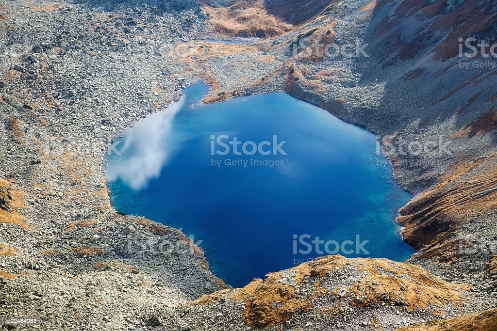 Emerald lake in valley stock photo