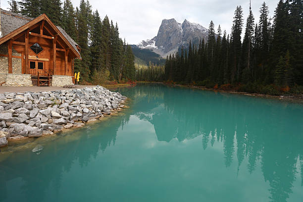 Emerald Lake in Yoho National Park, British Columbia, Canada Autumn afternoon at Emerald Lake in Yoho National Park, British Columbia, Canada. Emerald Lake is a major tourism destination in the Canadian Rockies. emerald lake stock pictures, royalty-free photos & images
