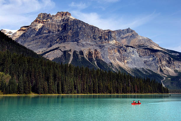 Emerald lake Boating on Emerald lake in Yoho national park, Canadian Rockies emerald lake stock pictures, royalty-free photos & images