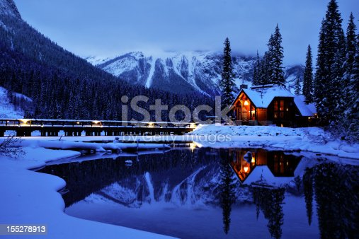 The road leading into Emerald Lake Lodge in Yoho National Park, British Columbia. The Restaurant reflects on the unfrozen water in this winter scene