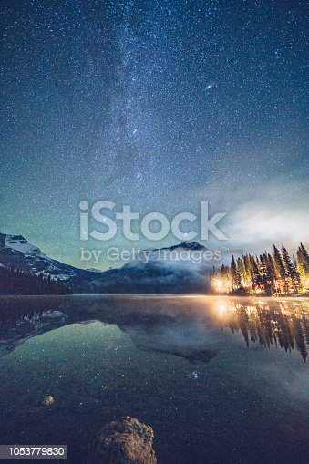 Emerald lake with illuminated cottage under milky way,and Mount Burgess on background,in Yoho national park,British Columbia, Canada.