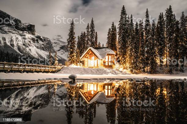 Emerald Lake With Lodge In Yoho National Park British Columbia Canada Shot At Night With Lights On In The Chalet Reflection On Lake Stock Photo - Download Image Now