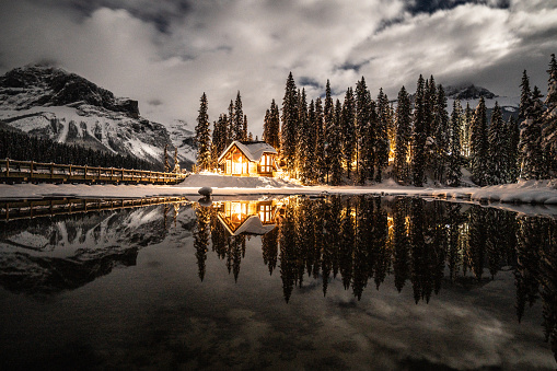Emerald lake with lodge in Yoho national park, British Columbia, Canada; shot at night with lights on in the chalet reflection on lake