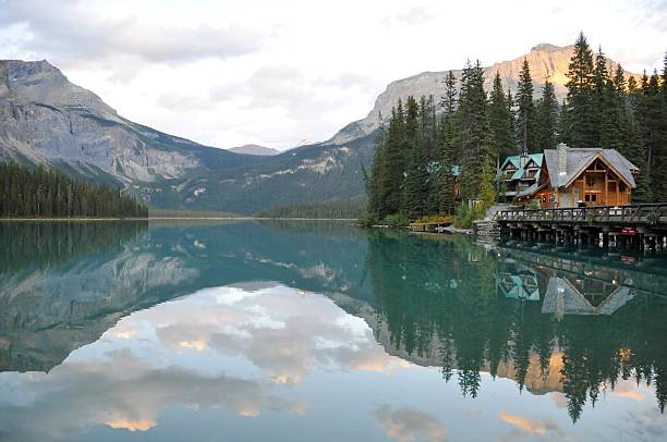 Emerald Lake with lodge , Yoho National Park,British Columbia,Canada Landscape with Emerald Lake Logde reflected in Emerald Lake in Yoho National Park,British Columbia,Canada. emerald lake stock pictures, royalty-free photos & images