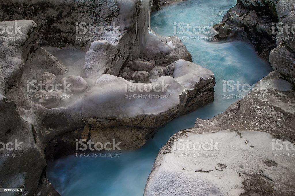 Emerald Soca river in the ice shell stock photo