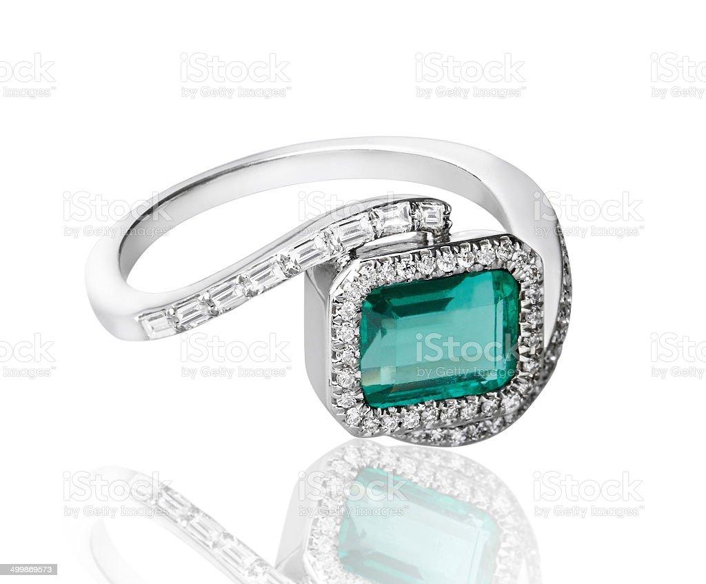 Emerald white gold diamond ring stock photo