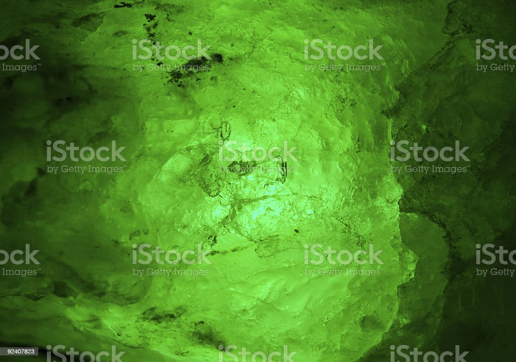 Emerald-green mineral glowing from inside stock photo